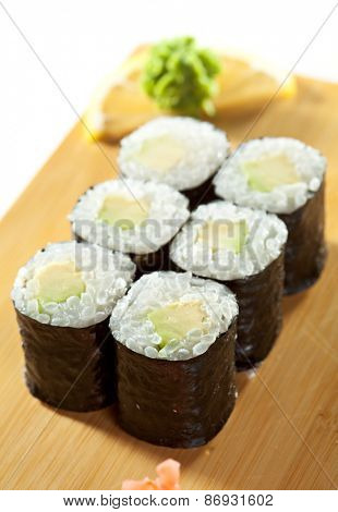 Avocado Sushi Roll with Wasabi and Ginger on the Wood Plate