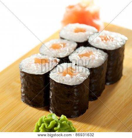 Sake Maki Sushi - Roll with Fresh Salmon on the Wood Plate