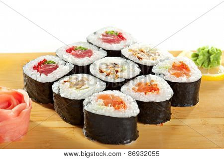 Maki Sushi - Roll made of Tuna, Salmon, Eel, Cream Cheese, Fruits and Vegetables inside. Nori outside