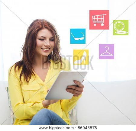 technology, people and internet concept - smiling woman sitting on couch with tablet pc computer shopping online at home