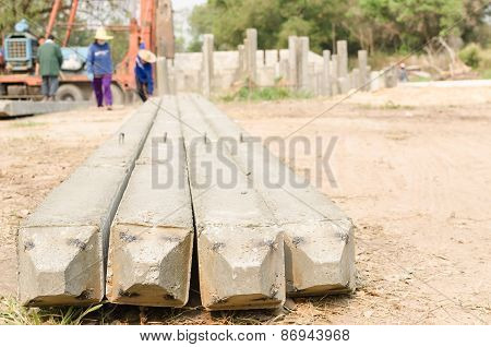 Bottom View Of Precast Concrete Piles On Blurry Construction Site  Background