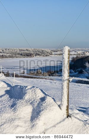 Fence Post In The Snow
