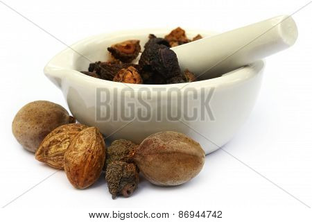 Triphala, A Combination Of Ayurvedic Fruits With Mortar And Pestle