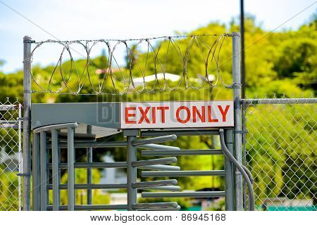 Exit Only Sign On Security Door With Barbed Wire