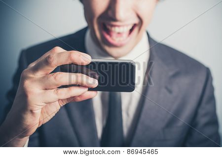 Happy Businessman Using His Smartphone