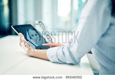 business, technology, communication and people concept - close up of woman holding tablet pc computer and having video chat with helpline operator at office or home