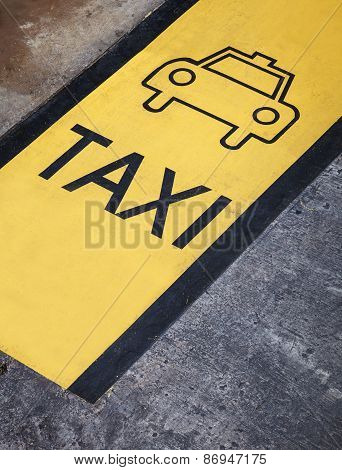 Taxi sign on street