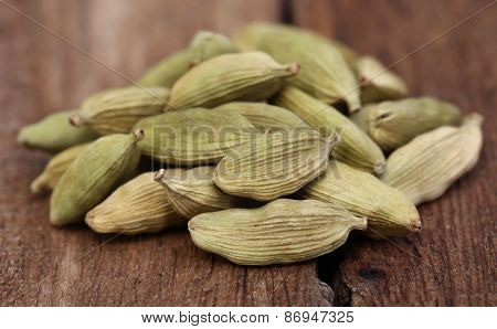 Cardamom Seed On Wooden Surface