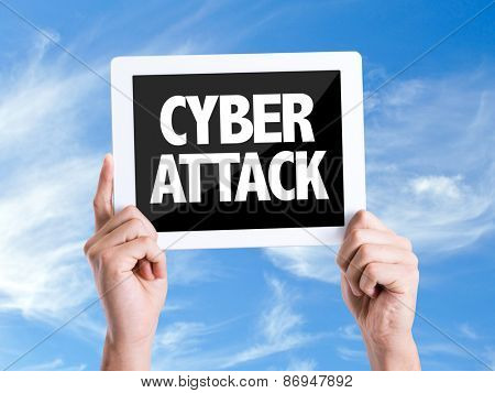Tablet pc with text Cyber Attack with sky background
