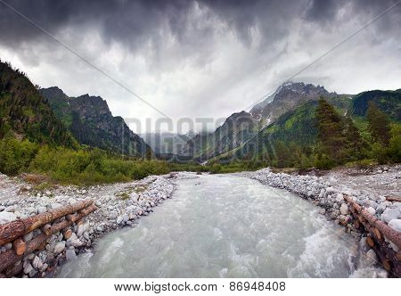 Summer Landscape With Mountain Stream And Dramatic Sky