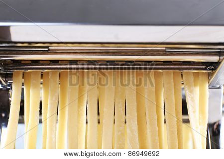 Making noodles with pasta machine, closeup