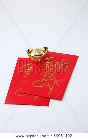 golden ingot with ang pao