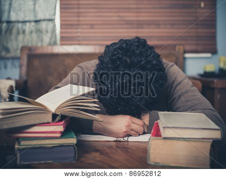 Tired Student Surrounded By Books