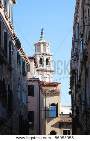 View Of A Bell Tower And Houses In Venice.