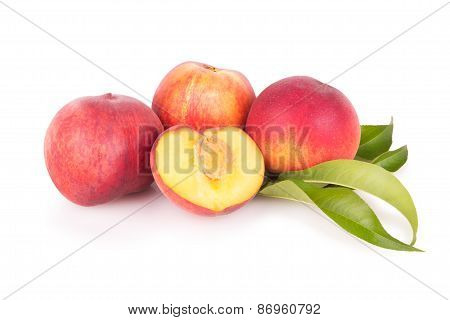 Group Of Fresh Peaches With Leaves