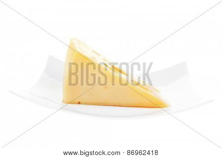 french gourmet triangle of parmesan yellow cheese  on a plate isolated over white background