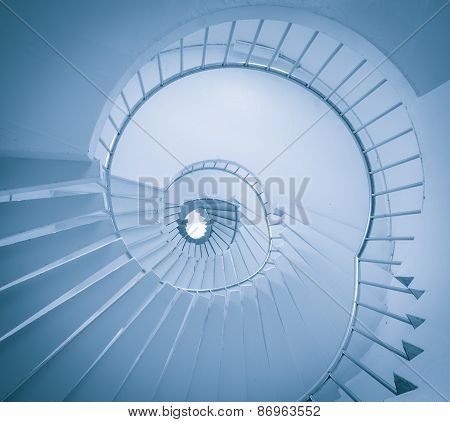 A Low Angle View Of A Spiral Staircase