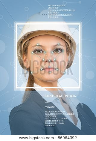 Concept of person identification. Beautiful builder in helmet. Face with lines