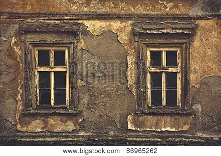 Old Windows On Ruined House Exterior Wall