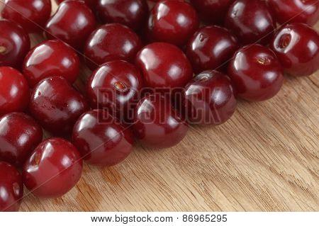 ripe cherries on wood table