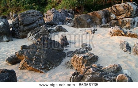 black stones on light sand