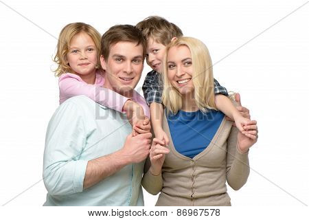 Smiling family of four enjoying time together