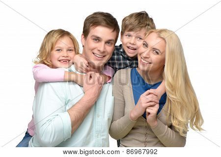 Cheerful children riding piggyback on parents