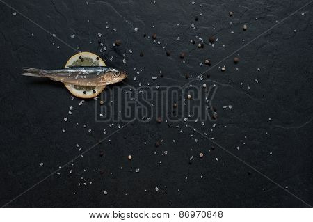 Small Fish With Salt And Pepper On The Table