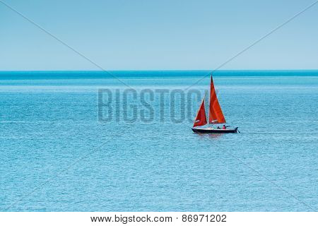 Solo yacht on a calm sea
