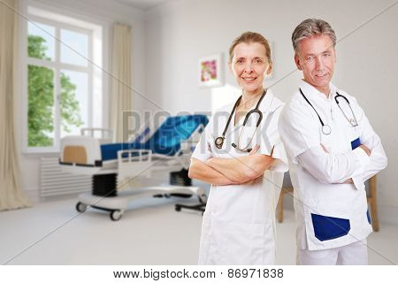 Competent team in nursing home with doctor and nurse in empty room