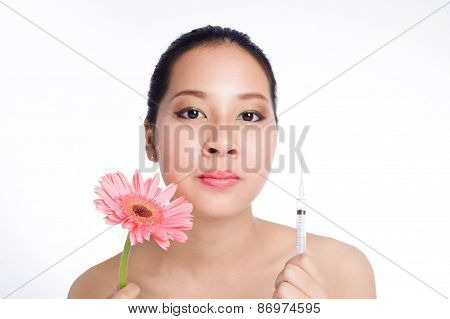 Beautiful Woman With Syringe And Flower
