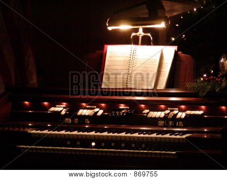 Organ at night with music and Christmas decorations