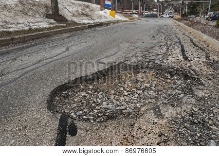 Big pothole in road