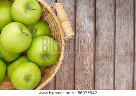 Wicker Basket Of Crisp Green Apples