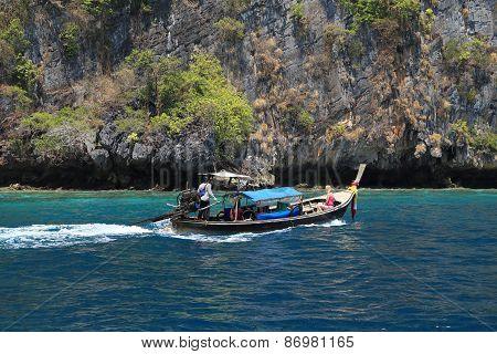 Wooden Boats With Traveller On Turquoise Water Of Koh Phi Phi Island