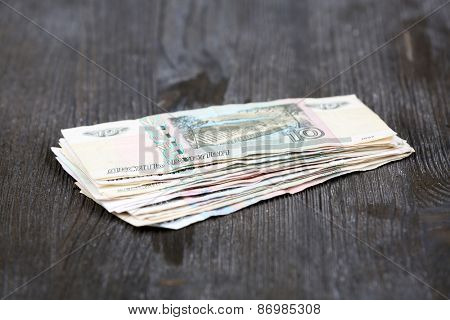 Stack of money on table close up