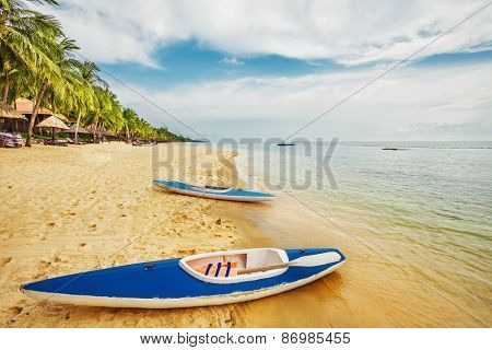 Kayaks at the tropical beach at Phu Quoc island  in Vietnam