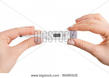 Female hands holding thermometer isolated on white