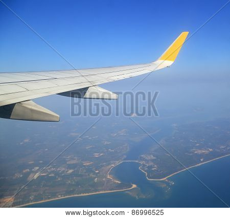 Wing Of An Airplane Flying Above Sky