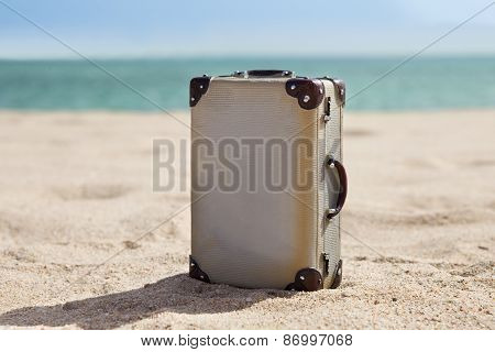 Old Suitcase On Beach