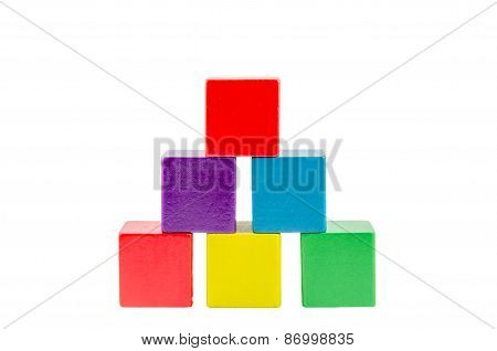 Wooden colored building pyramid of cubes toys isolated on white background