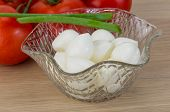 stock photo of shredded cheese  - Mozzarella cheese balls with onion and tomato branch - JPG