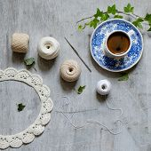 stock photo of crotch  - Crochet work and a cup of coffee - JPG