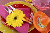 foto of gerbera daisy  - Happy Cinco de Mayo bright colorful party table place setting with bright gerbera daisy flowers on distressed red wood table - JPG