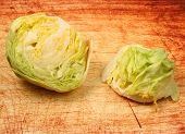 picture of iceberg lettuce  - a lettuce head on a wood table top - JPG