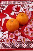 pic of mandarin orange  - mandarin oranges on the red paper cutting - JPG