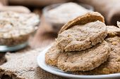 pic of oats  - Some Oat Cookies on rustic wooden background  - JPG