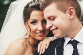 stock photo of bridal veil  - Groom suit and bride in wedding white dress on nature - JPG