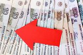 picture of depreciation  - Red arrow on Russian money as depreciation of currency - JPG