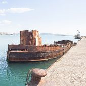 picture of wrecking  - Rusty wreck moored abandoned in the pier in the harbor of Cagliari Sardinia - JPG